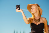 Beautiful elegant woman caught on taking pictures - 209787151
