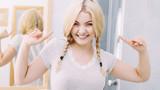 Happy woman having braided blonde hair