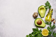 Leinwanddruck Bild - Food background with ingredients for making mexican avocado dip guacamole.Top view with copy space.