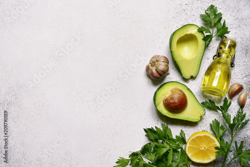 Leinwanddruck Bild Food background with ingredients for making mexican avocado dip guacamole.Top view with copy space.