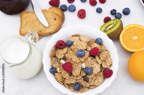 Foto Murales breakfast with fruits and cereals, health and wellness