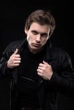 Resolute man in black jacket waist up shot - 209812358