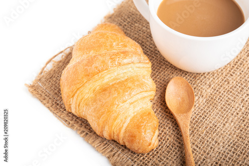 Wall mural Coffee and croissant on white background