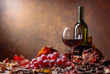 Glass and bottle of red wine . - 209824155