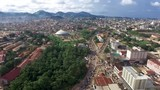 Drone flyover city of Yaoundé park at the center of town - 209826969