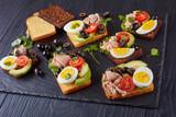 tuna sandwiches on a slate tray - 209829590