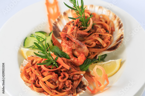 Fancy served meal. Seafood pasta in shells - 209833304