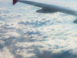 Flying above the clouds by the airplane - 209833730