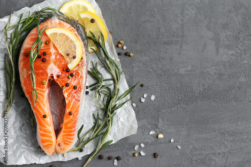 salmon steak with rosemary and lemon - 209835771