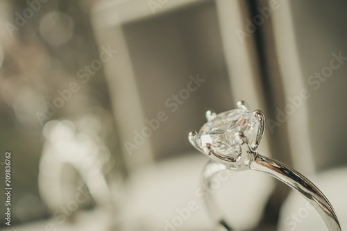 Leinwanddruck Bild luxury engagement Diamond ring in jewelry gift box with bokeh light background