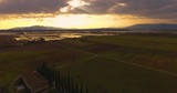 Aerial, beautiful tuscan landscape with cypress trees and a huge villa on sunset - 209842547