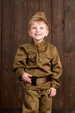 children are dressed as soldier in retro military uniforms - 209843922
