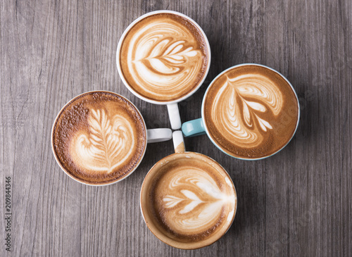 Wall mural latte or Cappuccino with frothy foam, coffee cup top view on table in cafe.