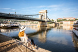 Young woman tourist enjoying morning view on the old town with Chain bridge and river traveling in Budapest city, Hungary - 209847173