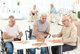 Senior people playing lotto at care home - 209848130