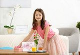 Little girl preparing surprise for her mommy on Mother's Day indoors - 209848311