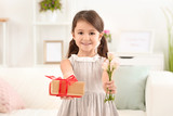 Little girl with gift and flowers for her mommy on Mother's Day indoors - 209848349