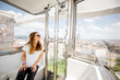Leinwanddruck Bild - Young woman tourist enjoying aerial cityscape view from the ferries wheel in Budapest city, Hungary