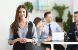 Young smiling businesswoman in conference room - 209848550