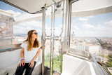 Young woman tourist enjoying aerial cityscape view from the ferries wheel in Budapest city, Hungary - 209848557