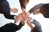 People putting hands together, view from below. Unity concept - 209848708