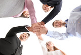 People putting hands together against white background, view from below. Unity concept - 209848739