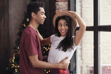 Attractive African-American couple dancing at home - 209849340