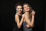 Beautiful young women with elegant jewelry on dark background - 209849501