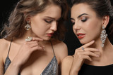 Beautiful young women with elegant jewelry on dark background - 209849546