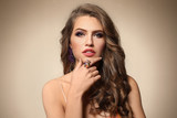 Beautiful young woman with elegant jewelry on color background - 209849575
