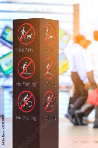 Fotobehang Amusementspark signage in fun park, no pets, no fishing and no cycling