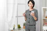 portrait of a business woman in a white interior - 209854722