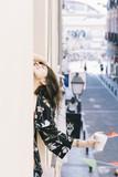 Girl drinking coffee in balcony - 209866550
