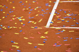Confetti on a tennis clay court