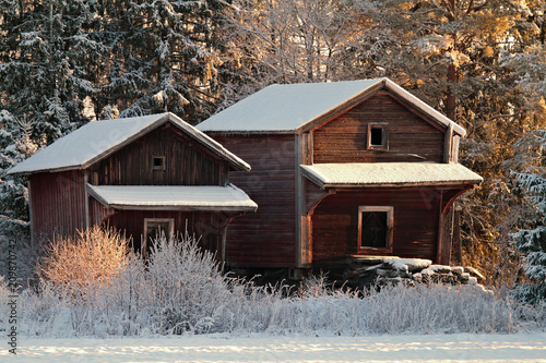 Foto Murales Two old barns in wintry scnery