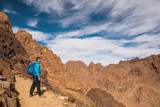 Woman Hiker with backpack enjoy view in desert - 209881100