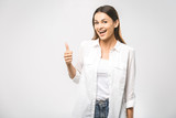 Young happy cheerful woman showing thumb up. Confident young businesswoman giving the thumbs up against a white background. Place for text. - 209885192