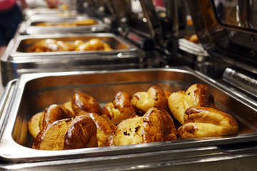 Rolls on the buffet. the range of pastries.