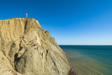 Girl standing on the edge of cape - 209887795