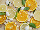 Close Up of Fresh Orange Lemon Sea Shells Leaves Cube Ice Summer Background Pattern - 209892916