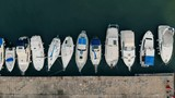 Row of boats located along the pier on a view from above - 209897367