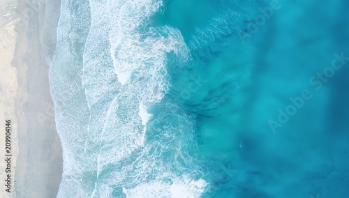 Waves on the beach as a background. Beautiful natural background at the summer time © Biletskiy Evgeniy
