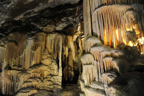 underground view of stalactites and stalagmites in natural halls in Postojna cave, Slovenia, Europe - 209907753
