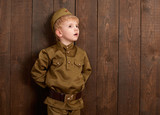 children are dressed as soldier in retro military uniforms - 209915126
