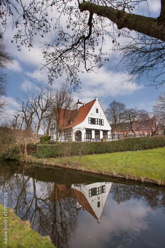 Fotobehang Brugge Brugge - medieval house over a canal in Bruges, Belgium