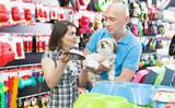 Couple purchasing pet bowls in pet shop © JackF