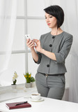 portrait of a business woman in a white interior - 209941946