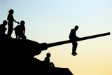 silhouettes of children climbing the tank - 209955331