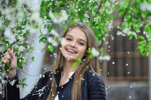 Foto Murales spring blooming concept.spring girl in blossom tree with happy face.