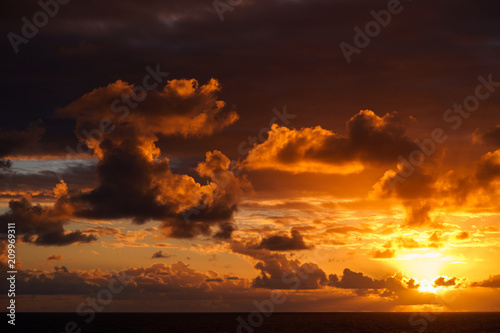 Aluminium Rood paars Beautiful sunset in atlantic ocean with amazing clouds